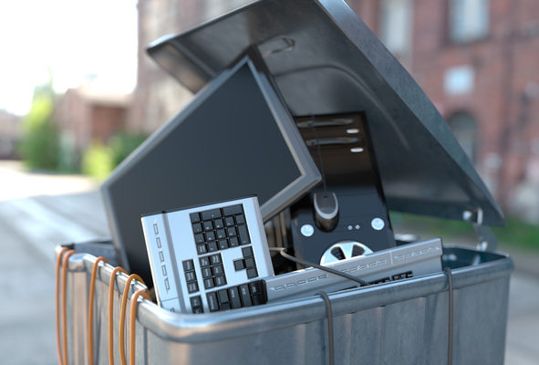 Computers in a trash bin