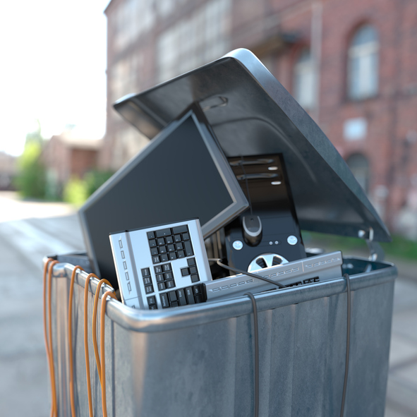 Computers in a trash bin