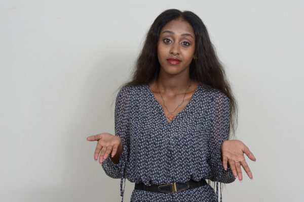 African woman shrugging shoulders