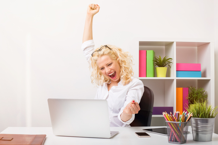 Beuatifull woman at the office celebrating her success