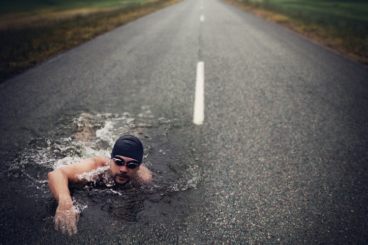 Strong Man Swim On Asphalt Road
